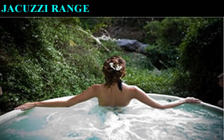 Woman in a jacuzzi overlooking a green valley